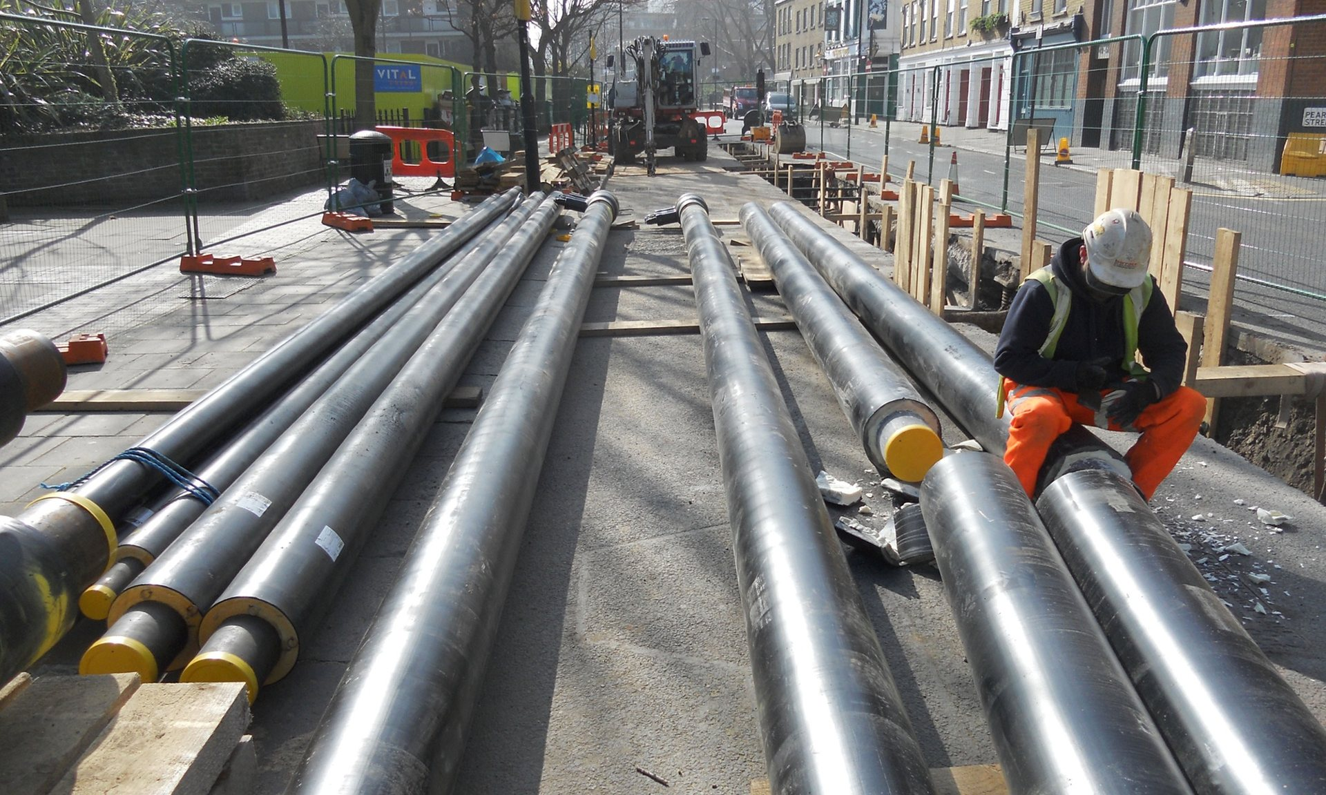 A workman installing heat network pipes in Islington, London.