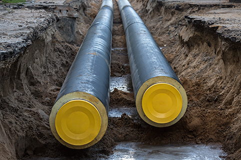 A close-up photograph of large heat network pipes